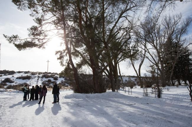 Members of the Johnson and Keady families of Burns, Ore. explore the Malheur National Wildlife Refuge headquarters, which is occupied by anti-government protestors, on Monday, Jan. 4, 2016. The fa ...