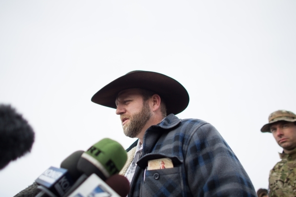 Ammon Bundy, center, speaks with reporters at a news conference by the entrance of Malheur National Wildlife Refuge near Burns, Ore., on Monday, Jan. 4, 2016. Bundy, the son of Nevada rancher Cliv ...