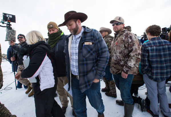 Ammon Bundy, center, walks with supporters after speaking with reporters at a news conference by the entrance of Malheur National Wildlife Refuge near Burns, Ore., on Monday, Jan. 4, 2016. Bundy,  ...