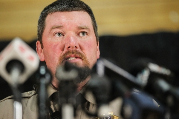 Harney County Sheriff Dave Ward, left, speaks during a news conference at Lincoln Junior High School in Burns, Ore. on Monday, Jan. 4, 2016. Law enforcement has set up at the school in response to ...