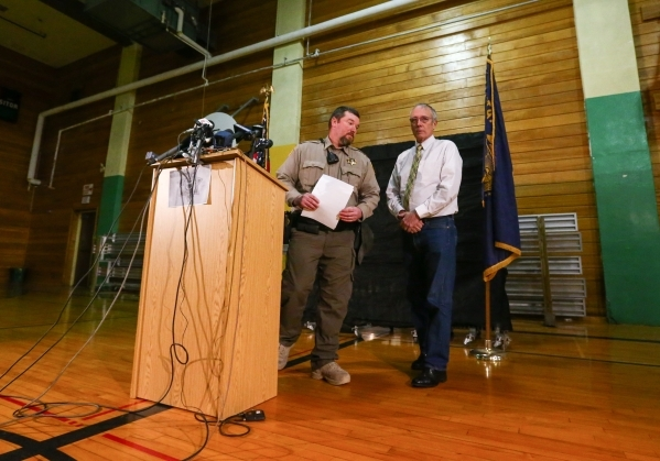Harney County Sheriff Dave Ward, left, walks after speaking at a news conference as Judge Steven Grast looks on, at Lincoln Junior High School in Burns, Ore. on Monday, Jan. 4, 2016. Law enforceme ...