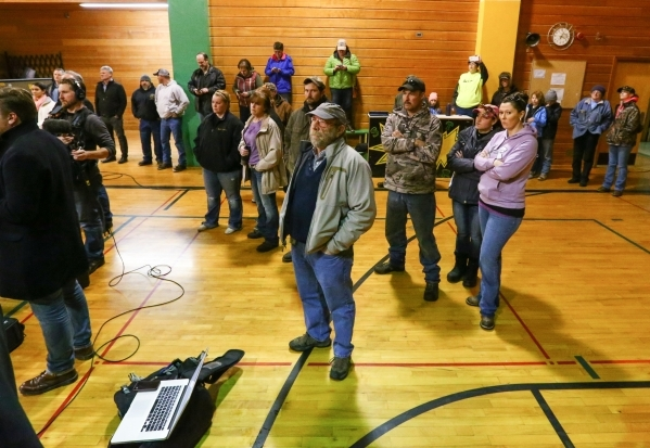 Area residents and news media look on during a a news conference held by the Harney County sheriff at Lincoln Junior High School in Burns, Ore. on Monday, Jan. 4, 2016. Law enforcement has set up  ...