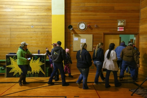 Area residents leave after a a news conference held by the Harney County sheriff at Lincoln Junior High School in Burns, Ore. on Monday, Jan. 4, 2016. Law enforcement has set up at the school in r ...