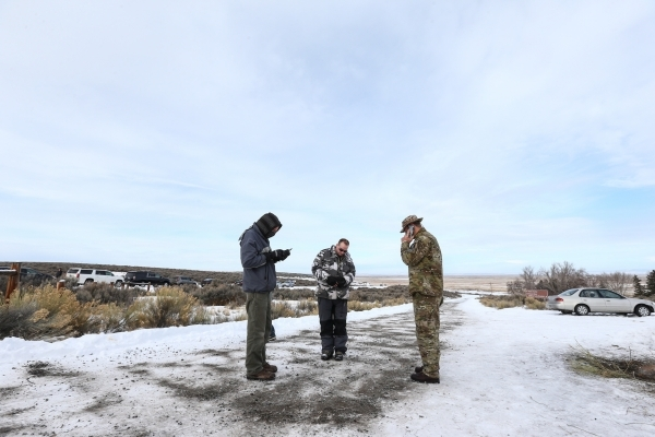 Anti-government protestors stand guard by the entrance of Malheur National Wildlife Refuge, which they are currently occupying, near Burns, Ore., on Monday, Jan. 4, 2016. The protestors, many of t ...