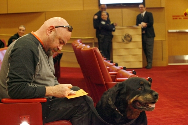 Don Knetzger sits with his dog Buck and fills out a form to speak at the Las Vegas City Council hearing on the retail sale of cats and dogs on Wednesday, Jan. 6, 2016. Michael Quine/Las Vegas Revi ...