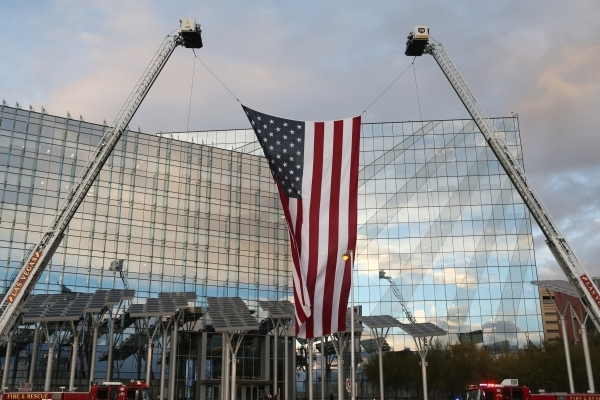 An American flag flies over two fire trucks in front of Las Vegas City Hall in advance of the annual State of the City address from Mayor Carolyn Goodman on Thursday, Jan. 7, 2016, in Las Vegas. E ...