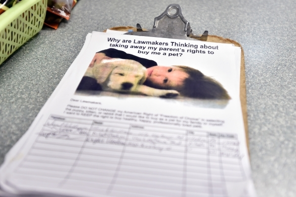A petition to stop a proposed city ordinance is available for customers' signatures at a Petland store Monday, Jan. 4, 2016, in Las Vegas. The City of Las Vegas will consider a possible ban  ...