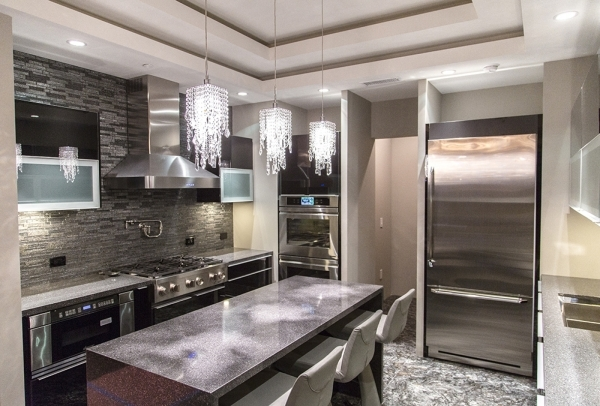 AFTER: Unit No. 4105 in Mandarin Oriental measures 2,755 square feet.. It is not for sale but will be showcased at the 2016 International Builder's Show. Its kitchen features custom chandeli ...