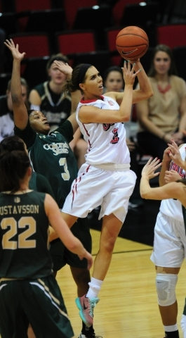 UNLV Rebels guard Brooke Johnson (2) makes a layup attempt in front of Colorado State forward Keyora Wharry (3) in the second quarter of their NCAA women's college basketball game at the Cox ...
