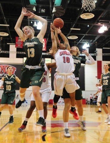 UNLV Rebels guard Nikki Wheatley (10) fights Colorado State guard Ellen Nystrom (13) and  forward Emilie Hesseldal (4) for a UNLV rebound in the fourth quarter of their NCAA women's college  ...