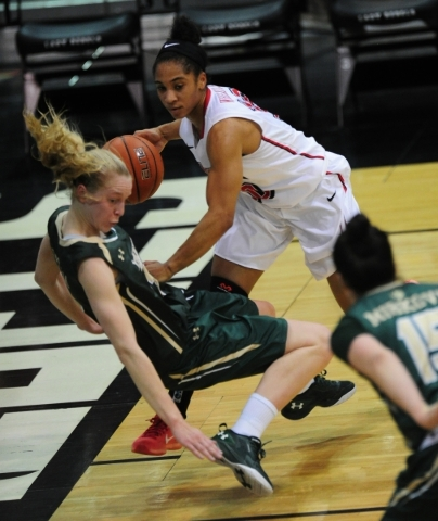 UNLV Rebels guard Nikki Wheatley (10) commits an offensive foul against Colorado State guard Ellen Nystrom (13) in the second quarter of their NCAA women's college basketball game at the Cox ...