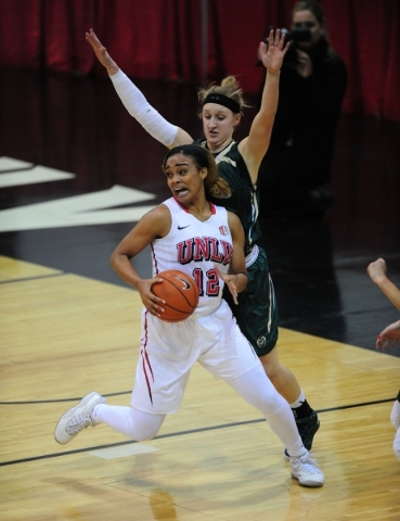 UNLV Rebels guard Dakota Gonzalez (12) makes a move against Colorado State guard Hannah Tvrdy (10) in the first quarter of their NCAA women's college basketball game at the Cox Pavilion Wedn ...