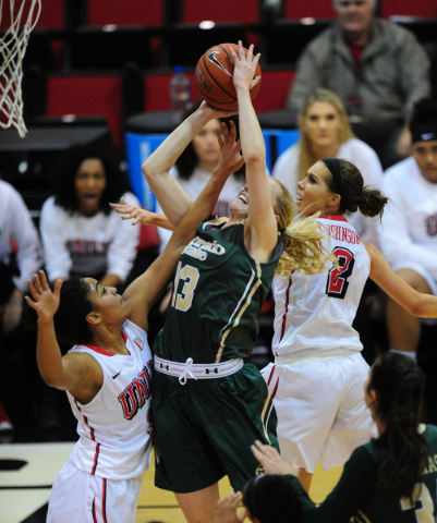 UNLV Rebels forward Paris Strawther (3) and guard Brooke Johnson (2) defend Colorado State guard Ellen Nystrom (13) in the first quarter of their NCAA women's college basketball game at the  ...