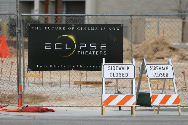 An advertisement and construction signs are shown outside the Eclipse Theaters construction project at 814 S. Third St. downtown Tuesday, Jan. 5, 2016, in Las Vegas. Ronda Churchill/Las Vegas Revi ...