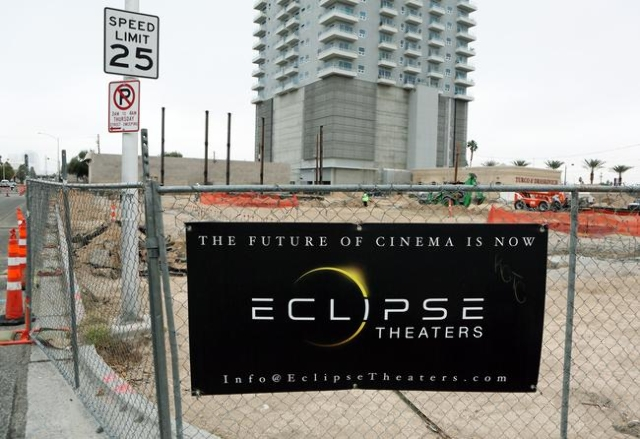 An advertisement is shown on the fence surrounding construction for the Eclipse Theaters project at 814 S. Third St. downtown Tuesday, Jan. 5, 2016, in Las Vegas. The Eclipse Theaters, under const ...