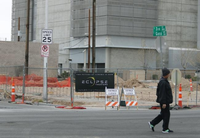 A pedestrian walks past construction for the Eclipse Theaters project at 814 S. Third St. downtown Tuesday, Jan. 5, 2016, in Las Vegas. Ronda Churchill/Las Vegas Review-Journal
