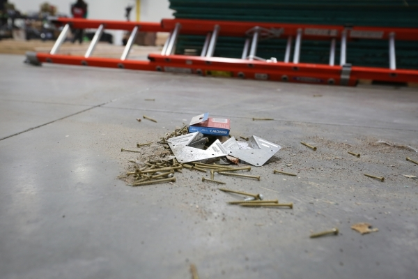 Screws from training buildings sit on the floor at the SolarCity training facility in Las Vegas on Tuesday, Jan. 5, 2016. SolarCity decided to shutter its Nevada-based installation and sales after ...
