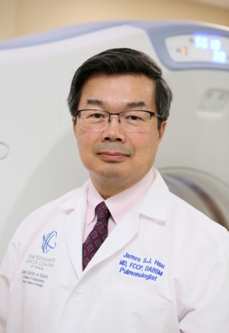 Dr. James Tsu, who specializes in pulmonary critical care medicine, is shown near a CT Optima 580 scanning machine at Comprehensive Cancer Centers of Nevada Wednesday, Jan. 6, 2016, in Las Vegas.  ...