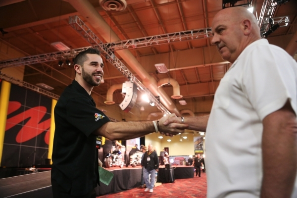 Bidder's assistant Blake Baugh, left, congratulates George Munsterman after buying a 1969 Honda Z50 motorcycle during the Mecum Auctions event at South Point casino-hotel on Saturday, Jan. 9 ...