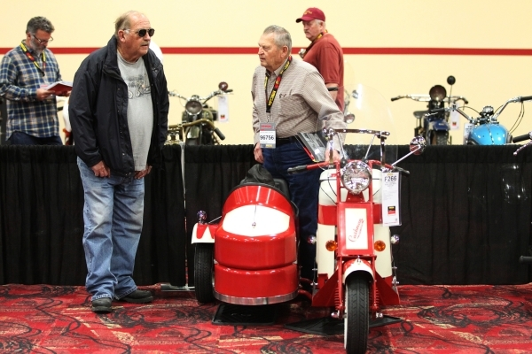 Chuck Hammack, left, asks Gerry Williams about his 1947 Cushman Road King with sidecar motorcycle on display during the Mecum Auctions event at South Point casino-hotel on Saturday, Jan. 9, 2016,  ...
