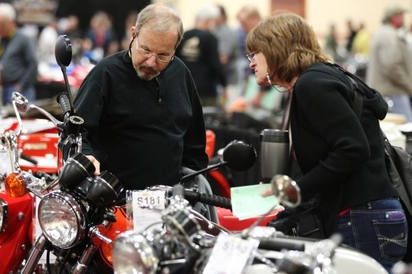 T.J. Jackson, left, and his wife Pam look at a 1973 Kawasaki Z1 900 motorcycle on display during the Mecum Auctions event at South Point casino-hotel on Saturday, Jan. 9, 2016, in Las Vegas. Erik  ...