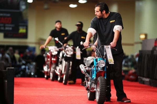 Nestor Sida displays a motorcycle on stage during auction at the Mecum Auctions event at South Point casino-hotel on Saturday, Jan. 9, 2016, in Las Vegas. Erik Verduzco/Las Vegas Review-Journal Fo ...