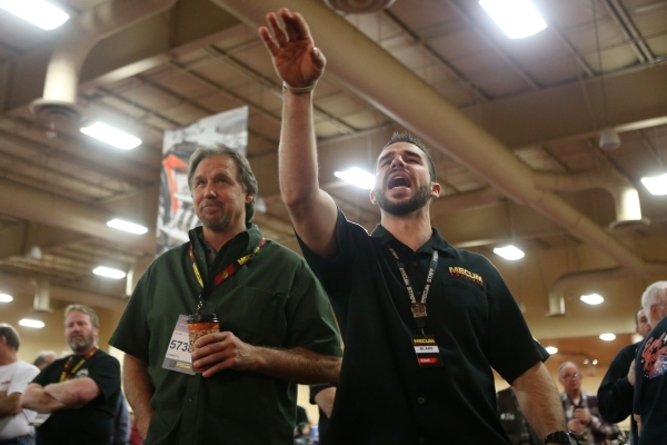 Bidder's assistant Blake Baugh, right, places a bid for Mike Oberle during the Mecum Auctions event at South Point casino-hotel on Saturday, Jan. 9, 2016, in Las Vegas. Erik Verduzco/Las Veg ...