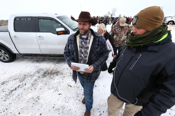 Ammon Bundy walks after speaking at a news conference by the entrance of Malheur National Wildlife Refuge headquarters near Burns, Ore. on Tuesday, Jan. 5, 2016. Bundy, who is the son of Nevada Ra ...