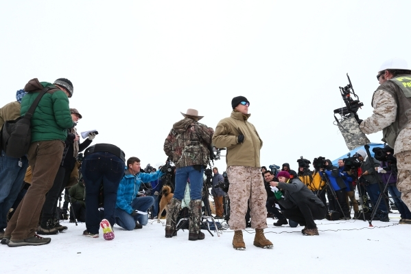 Arizona rancher and anti-government protestor LaVoy Finicum, center left, speaks during a news conference by the entrance to the Malheur National Wildlife Refuge headquarters, which the group is o ...