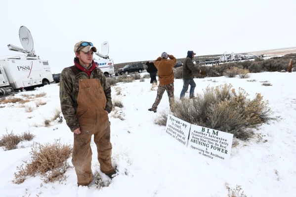 Anti-government protestors guard the entrance of the Malheur National Wildlife Refuge headquarters, which they are occupying, near Burns, Ore. on Tuesday, Jan. 5, 2016. The protestors, many of the ...