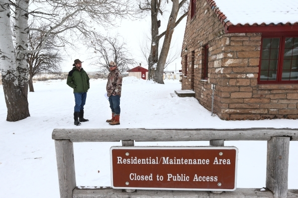 Environmental activist Don Francis, left, of Portland, Ore. talks with an anti-government protestor who declined to give his name at the Malheur National Wildlife Refuge headquarters, which the gr ...