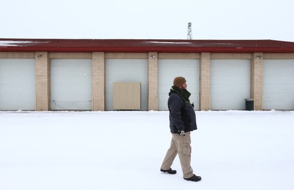 An anti-government protestor who declined to give his name walk around the Malheur National Wildlife Refuge headquarters, which the group is occupying, near Burns, Ore. on Tuesday, Jan. 5, 2016. T ...