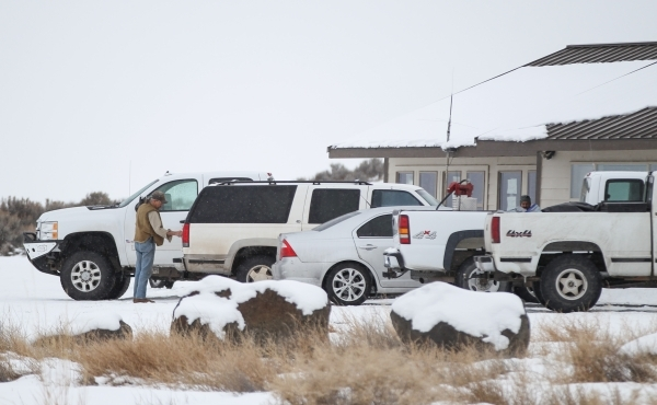 An anti-government protestor gets belongings from an SUV at the Malheur National Wildlife Refuge headquarters, which the group is occupying, near Burns, Ore. on Tuesday, Jan. 5, 2016. The protesto ...