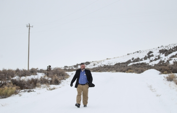 Anti-government protestor Jason Patrick walks around the Malheur National Wildlife Refuge headquarters, which the group is occupying, near Burns, Ore. on Tuesday, Jan. 5, 2016. The protestors, man ...