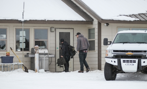 Anti-government protestors carry in belongings at the Malheur National Wildlife Refuge headquarters, which the group is occupying, near Burns, Ore. on Tuesday, Jan. 5, 2016. The protestors, many o ...