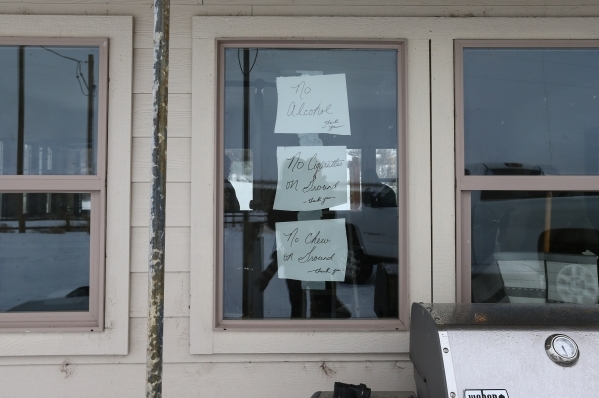 Written notes are taped to a window on a building at the Malheur National Wildlife Refuge headquarters, which is occupied by anti-government protestors, near Burns, Ore. on Tuesday, Jan. 5, 2016.  ...