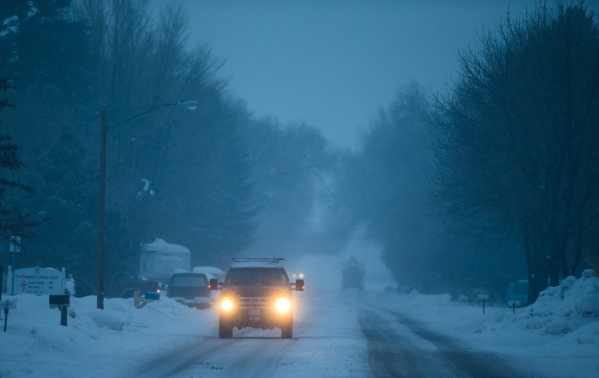 A truck drives along Egan Avenue in Burns, Ore. as snow falls on Tuesday, Jan. 5, 2016. Anti-government protestors have taken over the Malheur National Wildlife Refuge headquarters, about 30 miles ...