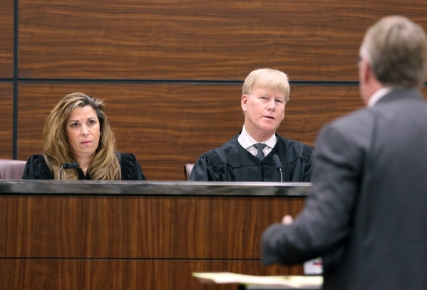 Judge Abbi Silver, left, and Chief Judge Michael Gibbons listen to an opening arguement during a session of Nevada Court of Appeals at the school Wednesday, Jan. 6, 2016, in Las Vegas. The court p ...