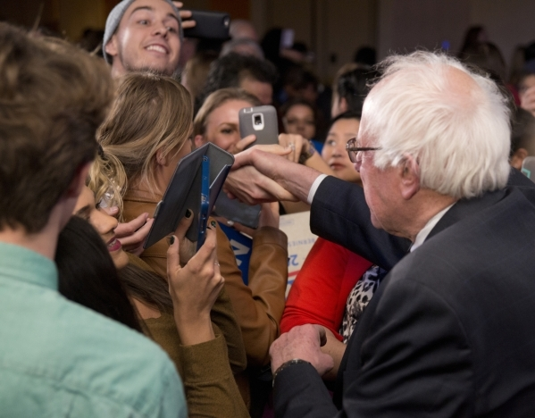 "Democratic presidential candidate Sen. Bernie Sanders, I-Vt., shakes hands with a member of the crowd during the ""Future to Believe In"" rally supporting Sanders inside the Tropicana hote ..."