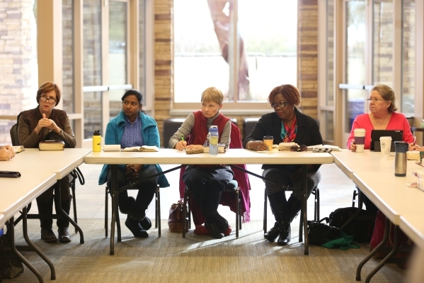 Victoria Courvoisier, from left, Roselin Prince, Jane Curbelo, Claribel Williams, and Trudy Fleishman listen during a bible study session at Desert Springs United Methodist Church Thursday, Jan. 7 ...