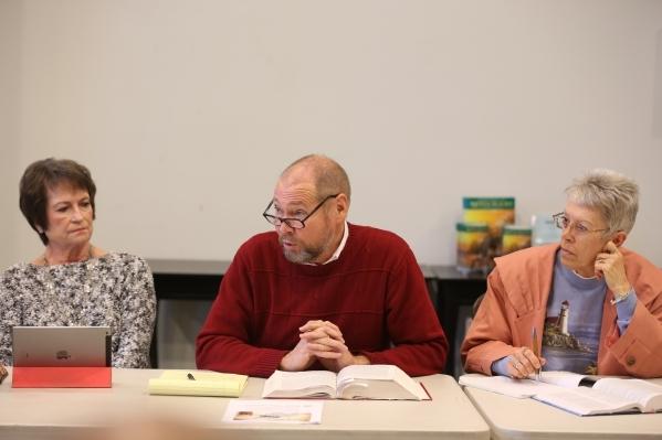 Linda Chapin, left, listens as Rev. David Devereaux, center, and Brenda Morrow, right, listen during a bible study at Desert Springs United Methodist Church Thursday, Jan. 7, 2016, in Las Vegas. R ...