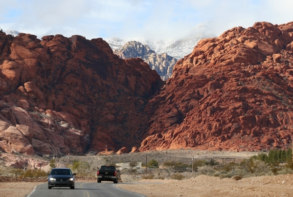 Vehicles make their way along Calico Basin Road near a cloudy and snow-topped Red Rock Canyon National Conservation Area Wednesday, Jan. 6, 2016, near Las Vegas. Ronda Churchill/Las Vegas Review-J ...