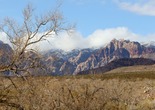 Clouds float over the mountains at a snow-topped Red Rock Canyon National Conservation Area Wednesday, Jan. 6, 2016, near Las Vegas. Ronda Churchill/Las Vegas Review-Journal
