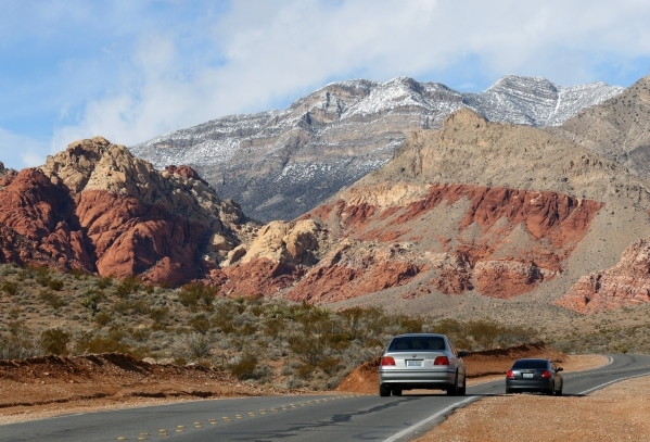 Cars make their way along Calico Basin Road near a cloudy and snow-topped Red Rock Canyon National Conservation Area Wednesday, Jan. 6, 2016, near Las Vegas. Ronda Churchill/Las Vegas Review-Journal