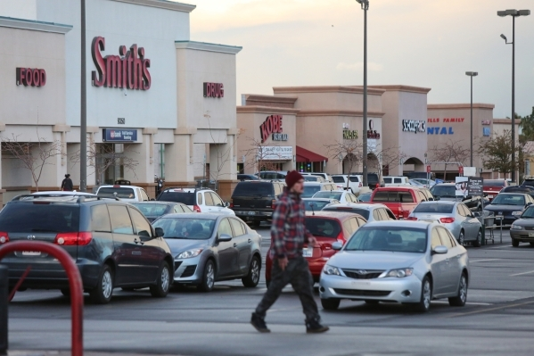 A pedestrian walks across the parking lot of the Smith's Shopping Center in Las Vegas on Thursday, Jan. 7, 2016. The Smith's Shopping Center, located on the northwest corner of South F ...