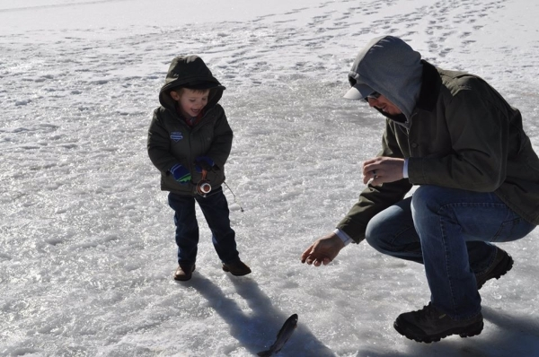 A young fisherman reels in a fish on Cave Lake during the annual Ice Fishing Derby sponsored by the Ely Rotary Club. This year's event at the 32-acre Ely reservoir is Jan. 30 and has a $5,00 ...