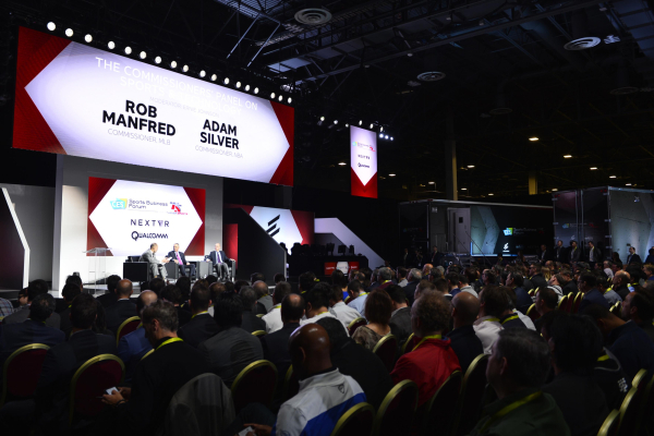 NBA commissioner Adam Silver, right, and Major League Baseball commissioner Rob Manfred, center, speak at the CES Sports Business Forum Thursday, Jan. 7, 2016, at the Venetian in Las Vegas. At lef ...