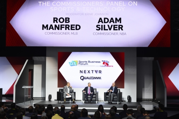NBA commissioner Adam Silver, right, speaks at the CES Sports Business Forum Thursday, Jan. 7, 2016, at the Venetian in Las Vegas. Listening to Silver are Major League Baseball commissioner Rob Ma ...