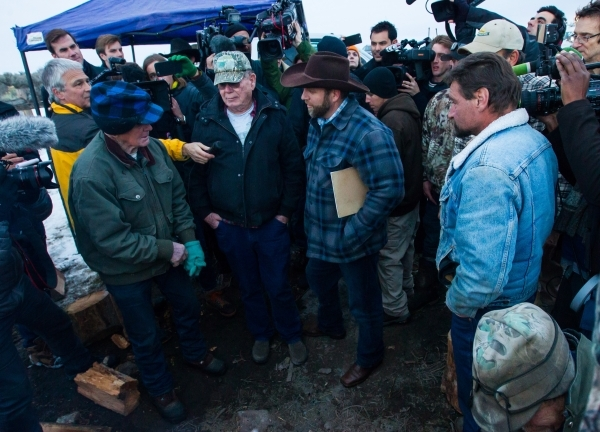 Ammon Bundy speaks with locals after meeting with Harney County Sheriff Dave Ward, at the Malheur National Wildlife Refuge headquarters near Burns, Ore. on Thursday, Jan. 7, 2016. The pair met abo ...
