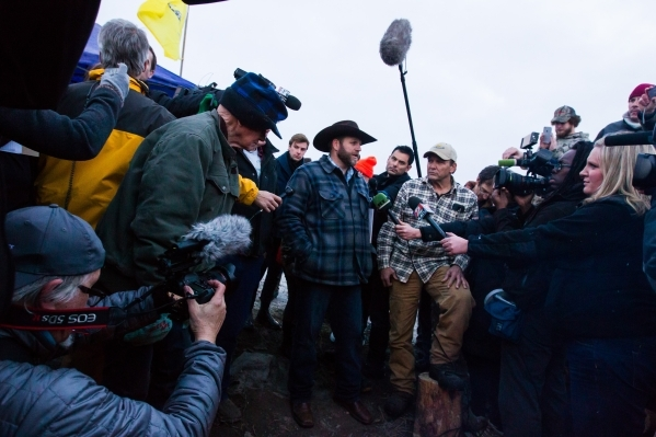 Ammon Bundy speaks with reporters after meeting with Harney County Sheriff Dave Ward, at the Malheur National Wildlife Refuge headquarters near Burns, Ore. on Thursday, Jan. 7, 2016. The pair met  ...
